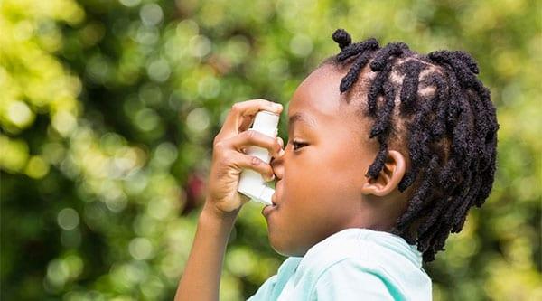 boy-using-inhaler
